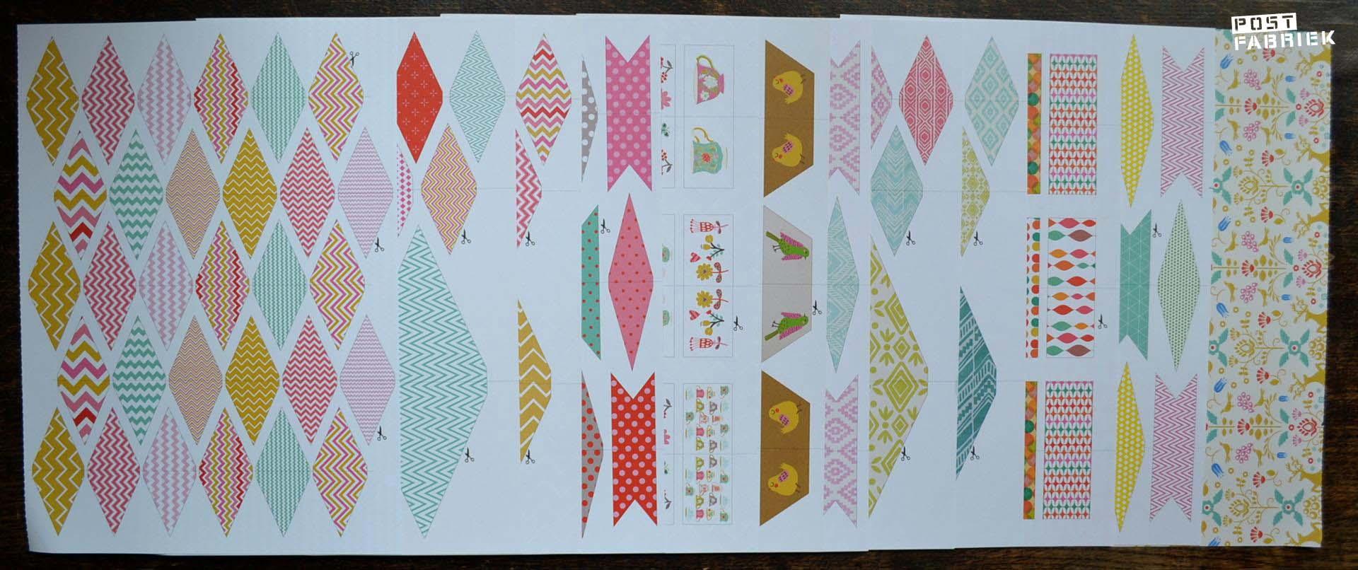 verschillende pagina's met uit te knippen vlaggetjes en prikkers
