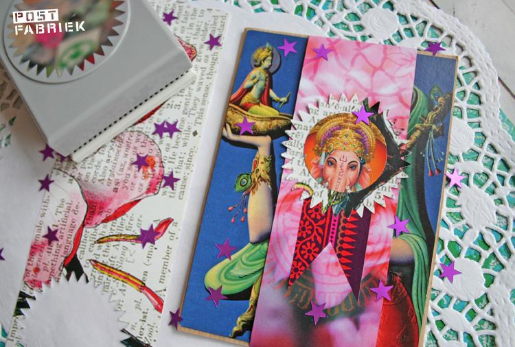 Ganesha-post. Het poststuk wordt samengebonden met een reepje papier. Bovenop zit een zelfgemaakte medaille-sticker geplakt. Helemaal gemaakt van kleine reststukjes van een tijdschrift.