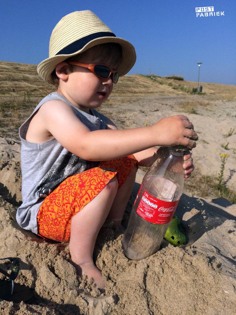 Zand in de fles doen