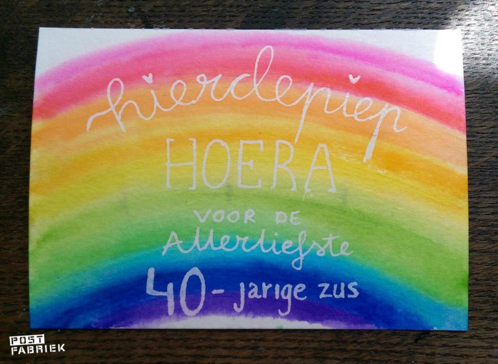 Een regenboog met de ZIG markers en Glaze pen gemaakt