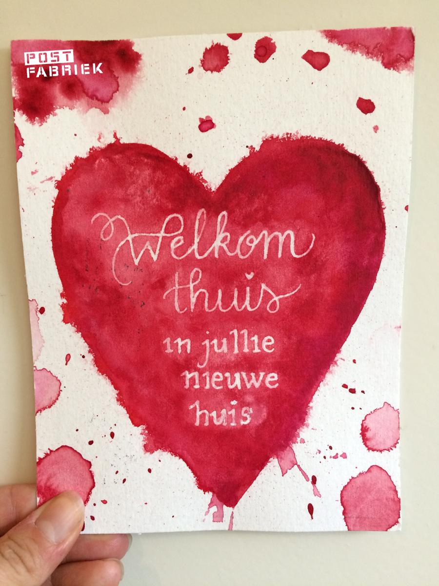 """Kaartje van Ruchama met """"Welkom thuis in jullie nieuwe huis"""" in een groot rood hart"""