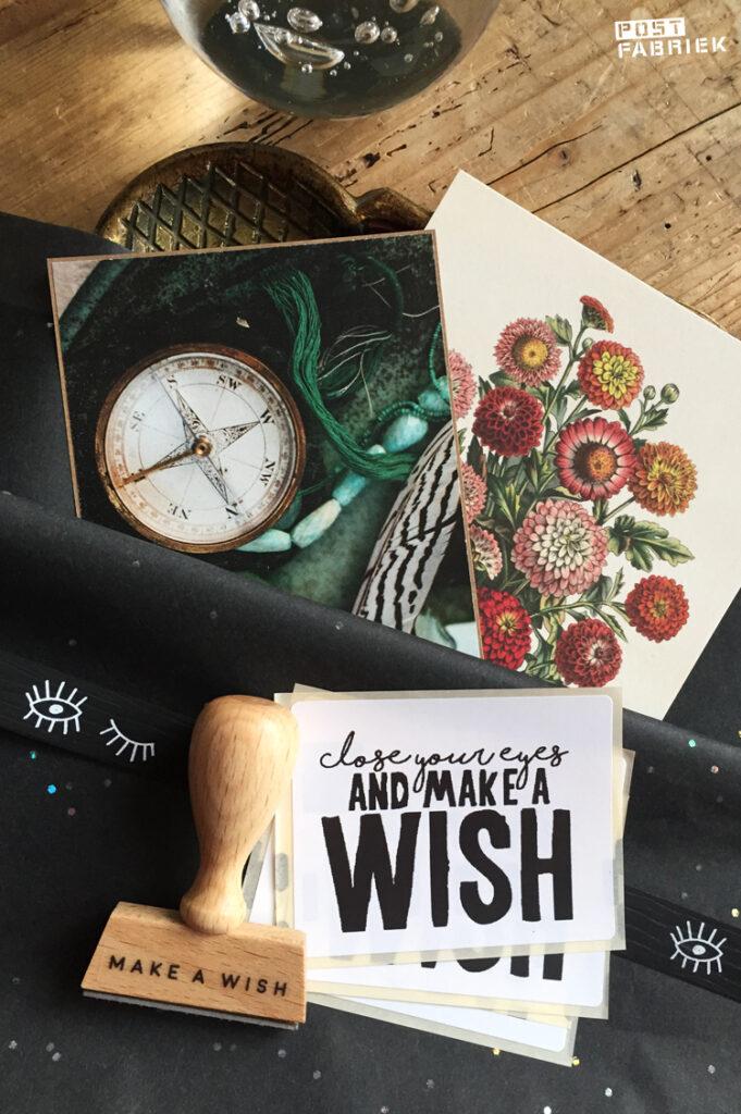 Een sticker met de tekst 'close your eyes and make a wish', verkrijgbaar bij Vlinders in je buik. En een stempel van Perlenfischer met de tekst 'make a wish'.