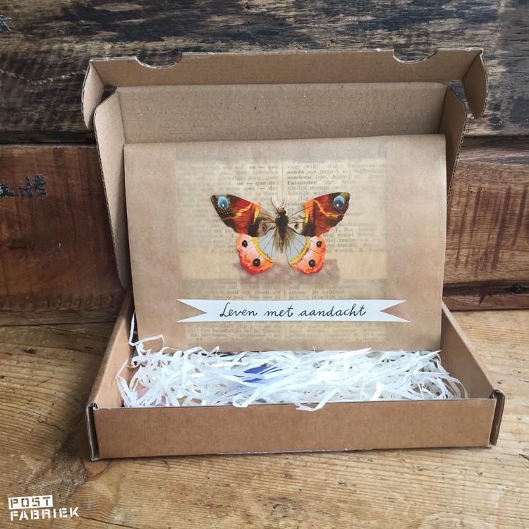 Een papieren boterhamzakje van Ecoplaza als cadeauverpakking