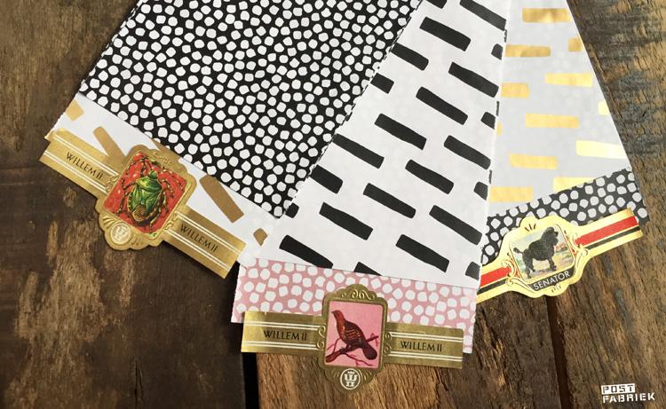 Drie verschillende varianten van de kleine cadeauzakjes gecombineerd met oude sigarenbandjes als sluitzegel. De zakjes zijn verkrijgbaar bij Vlinders in je buik.