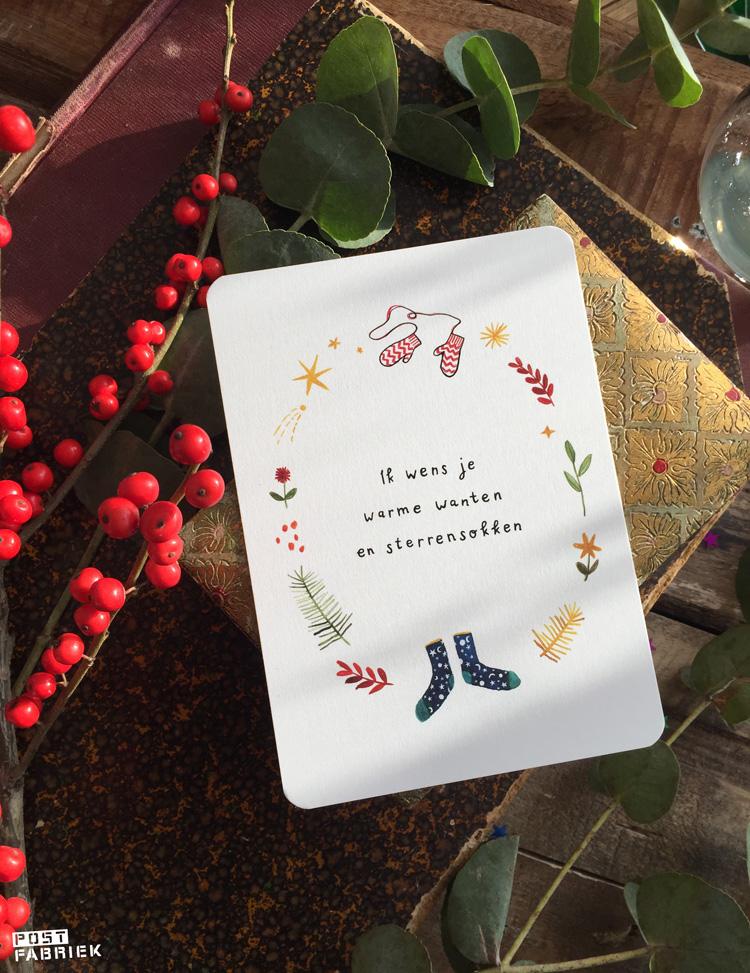 Een kaartje van Ninamaakt met de tekst: Ik wens je warme wanten en sterrensokken.